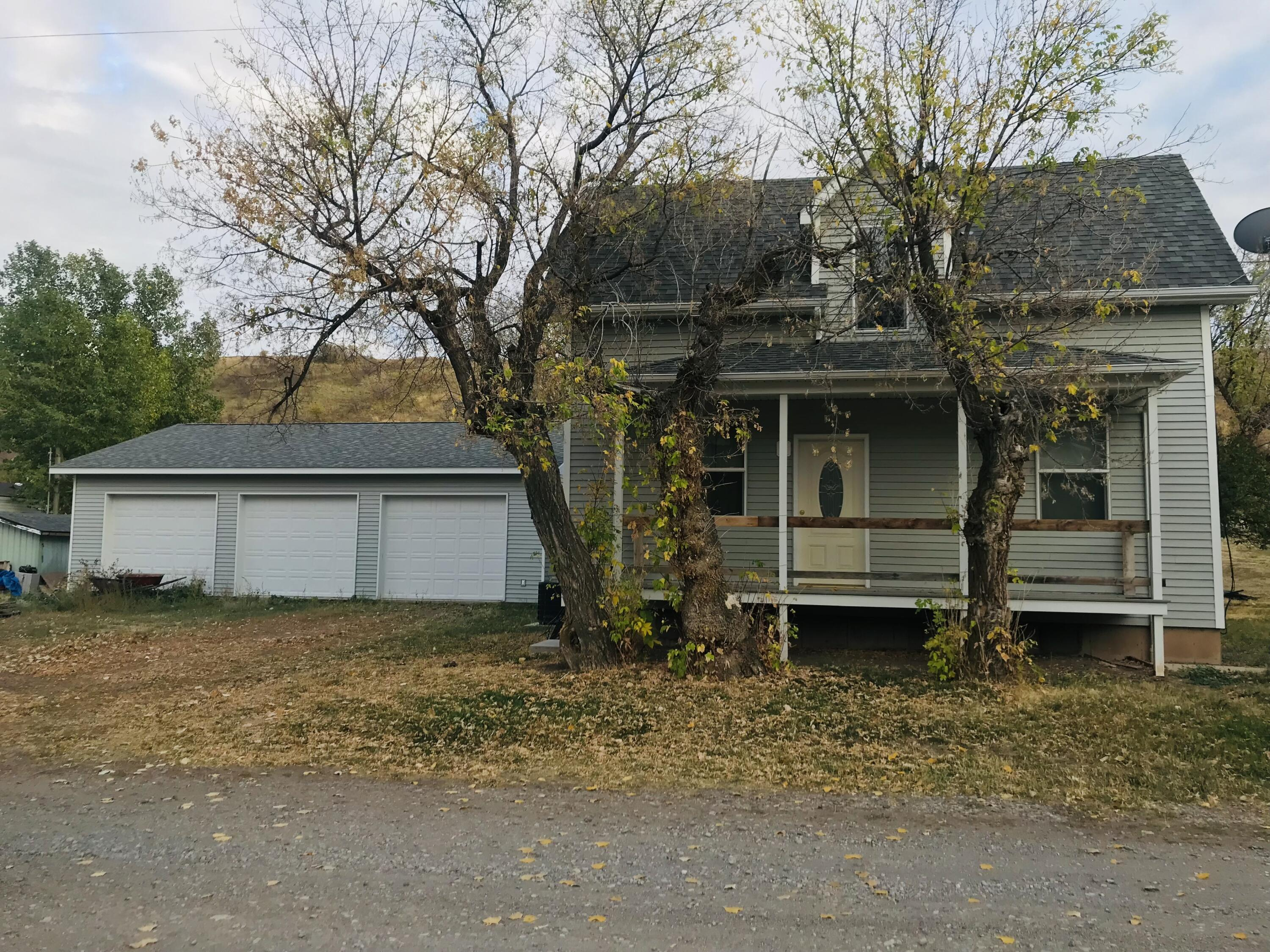 Looking to get a little ways out of town,  check out this nice little  FIXER in Stockett.  Newer foundation, siding, roof. windows.   Also has central air and comes with a built in generator. The interior needs Alot of TLC.  The 30x40 shop is heated and insulated and there is a great storage shed that is on a concrete slab and includes electricity.  The property is being sold ''AS IS'' with all its contents.