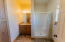 The suite has a private bath with large linen closet.