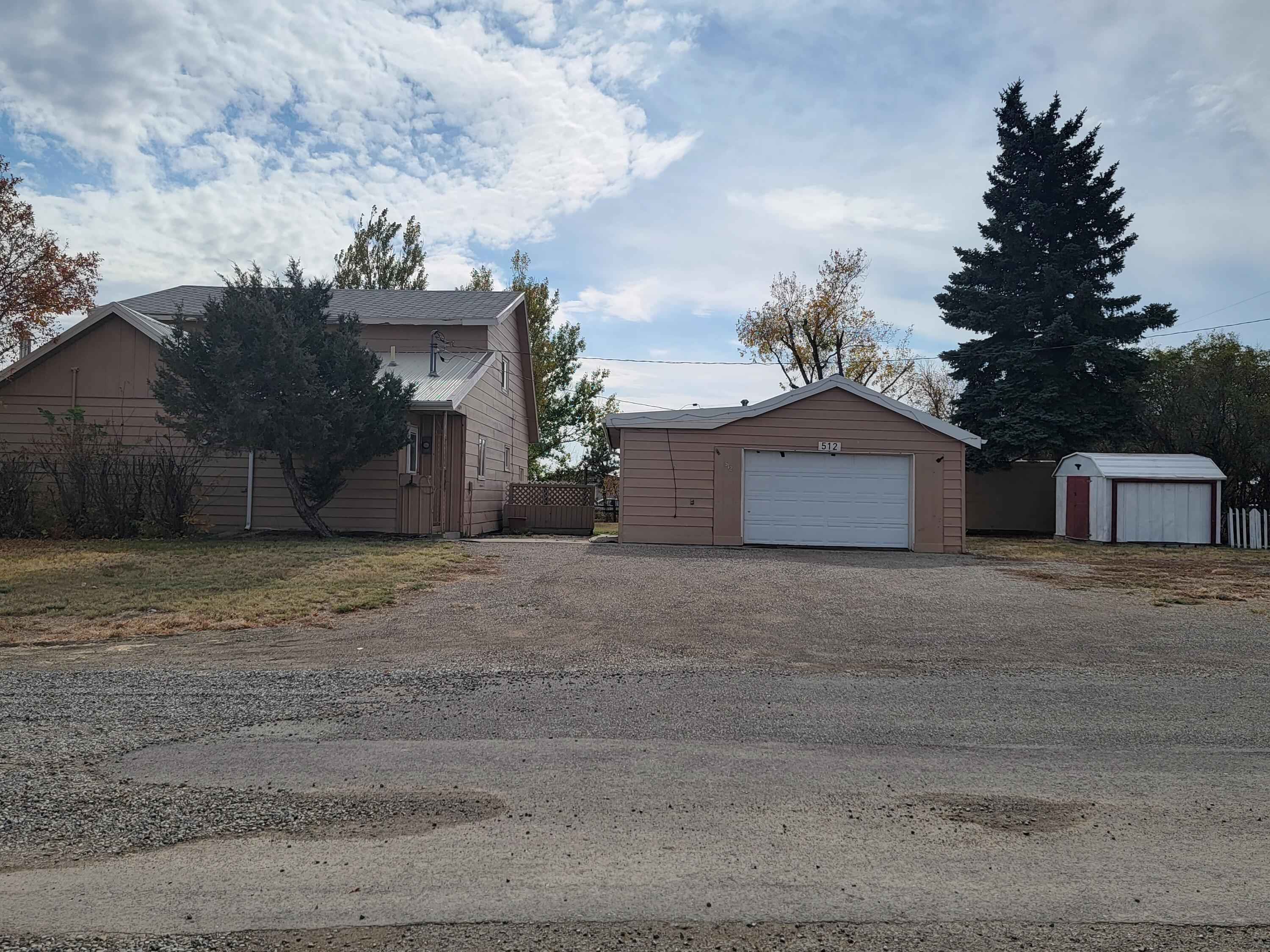 Do you need some room?  This home sits on .54 acres!  Two bedrooms on the main floor, two bedrooms on the second floor.  Addition  was started for a sun room!  Detached heated garage, greenhouse and 5 sheds!