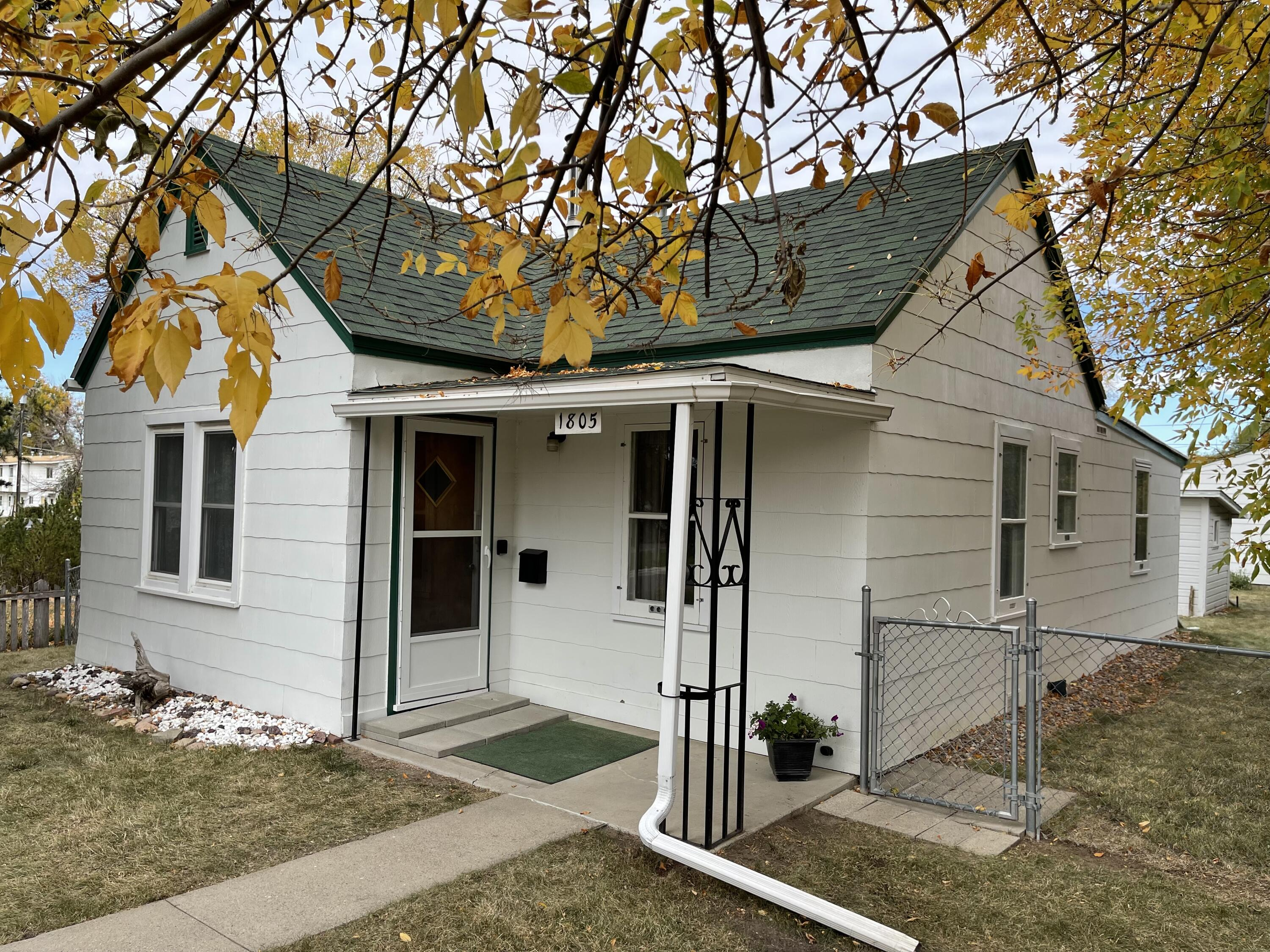 TINY LIVING AT IT'S BEST WITHOUT GIVING UP ALL THE EXTRA AMENITIES! Great fenced yard with mature landscaping, gardening shed, clothes line, RV parking, and oversized two stall garage with alley access. Well taken care of by owner for over 40 years. Property is being sold as is BUT please do your inspection to find out all you are getting at such a great price.