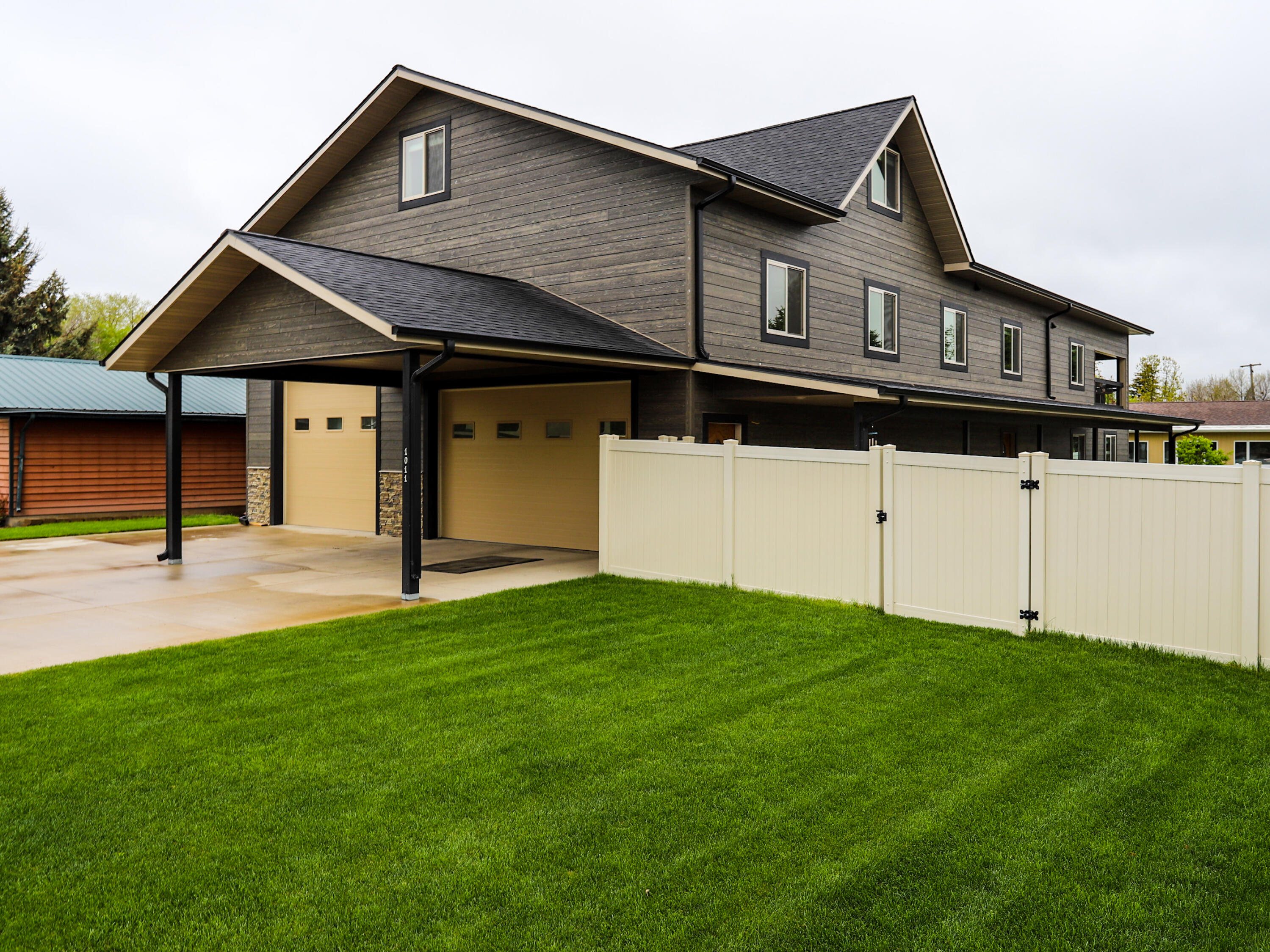 """Built in 2018 this Fox Farm home features 4 bedrooms, 3 full baths, & boasts over 3,000sqft. of living space. Talk about a man cave this home has the GARAGE/SHOP of your dreams, no need to keep your motor home outside anymore! In this space you are able to store your motor home, 4 full size vehicles, plus extra space for so much MORE! Inside the home enjoy the privacy of the master bedroom located on its own floor with its own en-suite bathroom & 2 walk in closets. The main living area is accompanied by enormous vaulted ceilings, a wide open concept with a modern design, & a beautiful walk out patio creating a perfect entertainment space. Featured on the main floor is a large bedroom with its own bathroom, walk in closet, & complete privacy from the rest of the house. This home gives you the """"country feel"""" while still being able to enjoy all the city amenities such as near by entertainment, restaurants, parks & schools. Don't miss out, Call Ambyr Rain Kleinholz at 406.781.2003 or your real estate professional to schedule a showing."""