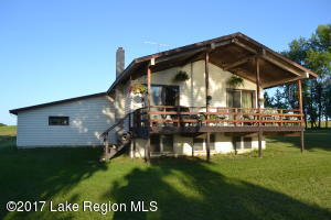 Located on the East side of Lida Lake, this home offers 105 x 238 lot with the opportunity to purchase the lot next to the home. Two bedrooms on main floor with options to utilize the full basement. Large living room facing the lakeside which walks out to the deck. As the property owner, enjoy a private lake access (no fees) for Lida View Lane property owners. No covenants.