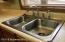 Stainless steel double sinks.