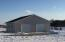 Heated 32' x 32' garage/shop. New garage door opener; includes set up to create a booth for doing auto body work.