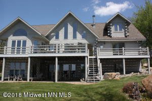 Spectacular custom built log home on prestigious Pelican Lake north shore. This home was built for entertaining family and friends. Lakeside deck runs full width of home with perfect sunset views! Open concept, tastefully decorated with wood and tile throughout. 5 bedroom/ 4 Bath (Main floor master) Great location close to wildflower golf and many local restaurants. Easy commute to Fargo/Mhd, Detroit Lakes, Fergus Falls Ready to move in and enjoy the lake!