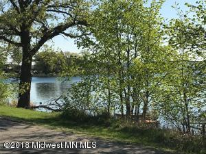 150 Feet of lakeshore on Little McDonald Premier swimming and fishing lake!! Nice 2.27 AC wooded lot to build your dream house! Road Between road and lake. Includes dock