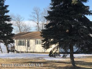 In the heart of a four season recreation area, sits a year around home with 105 x 238 lot located on the East Side of Lida Lake in Otter Tail County. The kitchen, living room, master, guest bedroom, bathroom, and laundry are all located on the main floor. The lower level has multiple options for your design. Enjoy a hard bottom elevated shore and private neighborhood access to launch. No covenants.