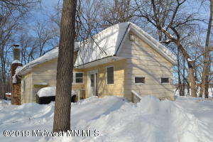 Property has been in the same family since 1950, the scenery is beautiful and serene, with approximately 2.5 acres and 350 feet of shoreline between the three lots. Property has a heavy tree growth of mature trees, sets on 153 acres of a Minnesota Lake (ACORN), and the right setting for travel to and from larger communities. Enjoy multiple options to use as a four season or seasonal property. The buildings will need work and updates. The shore has not been used in years. Winter and work cannot stop Spring, Summer, and Fall experiences.