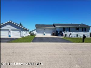 Affordable- Spacious 4 bdrm/2ba Home with BONUS 26x40 Heated garage shop! Lots of storage, finished basment , no maintence siding, newer roof, well maintained home. Great home to raise a family-move in ready!