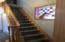 Gorgeous staircase and stained glass window