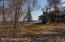 View of the lot and proximity to neighboring home that shares the driveway