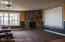 Beautiful cozy stone fireplace in LL walkout family room/theater room
