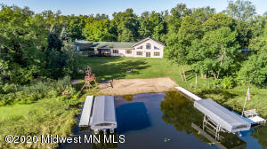 3.4 acre treed lot with gradual slope to beach. 1,000+ ft of lakeshore footage