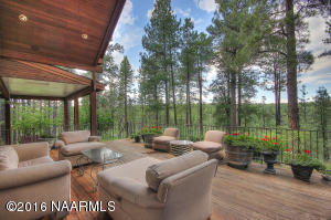Home backs to National Forest and covered deck below.