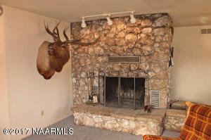 Large wood burning fireplace for everyone to keep warm during those cold months while family is visiting.