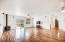 Large living/dining with engineered wood floor.