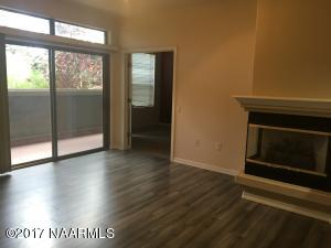 Spacious living room with 9 ft ceilings and gas fireplace.