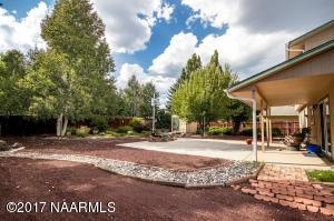 Covered patio and huge additional patio provides perfect yard for entertaining and family activities.