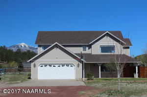 Front view of home, this is a great corner lot .