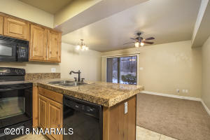 Open Living Area and Attractive Kitchen w/Granite Countertops and Handsome Cabinetry and Upgraded Appliances