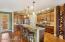 Kitchen boasts a large breakfast bar, walk-in pantry & lots of storage