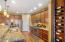"Custom Wine Rack & 42"" Maple Upper Cabinets complement the granite countertops"
