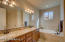 Double sinks & executive height vanity in the master bathroom