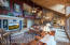 Kitchen is just beyond the rock statement wall.