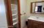 Vanity storage and linen closet in upstairs master bathroom