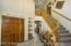 Elegant staircase opens to spacious foyer