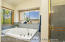 Large Soaking tub with golf course view