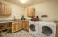 Brand new laundry room with Hickory cabinets