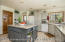 Large spacious granite top center island with new gorgeous tiled floors