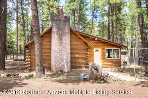Real log cabin on nearly a third of an acre backing forest service