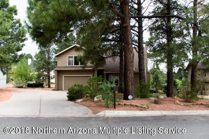Gorgeous Flagstaff home with beautiful trees and landscaping