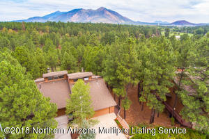Dont you move to Flagstaff to be in the trees? This home feels like a tree house