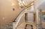 Dramatic Entry w/Sweeping Curved Staircase and Custom Travertine Flooring