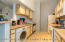Kitchen with dishwasher and washer/dryer combo