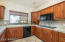 Great Kitchen with ceramic cook top, double ovens and walk-in pantry.