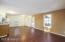 Open Great Room w/Handsome Laminate Flooring