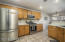 Kitchen with stainless steel appliances and brand new Quartz countertops