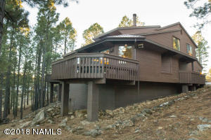 Side of Townhouse, great deck for enjoying the tall pines!