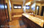 Dual Sinks in the Master, Along with a Private Water Closet. Natural Stone Countertops and Floors