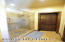A Large Natural Stone Shower, and a Walk In Closet with Ample Storage