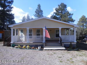 Wonderful three bedroom, two bath, two covered trex deck home