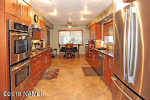 Recently updated kitchen with stainless steel appliances and quartz counter tops