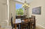 Even with a location just off the entry, the dining room feels like a tucked away spot in the home