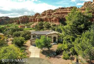 Beautifully encompased by inspiring RED ROCK VIEWS, this tranquil cul-de-sac custom home is the perfect retreat.