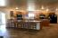 Large open kitchen with breakfast bar and island