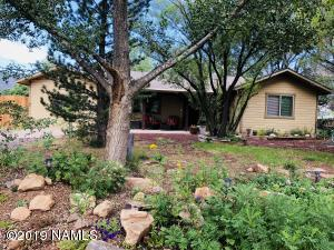 Heavily treed landscaped front yard offering lots of privacy and shade.
